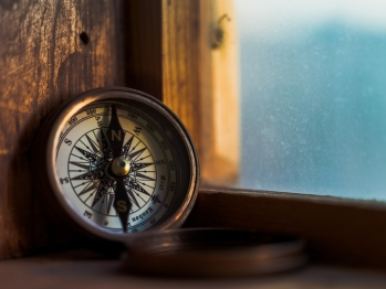 Open compass sitting on a windowsill