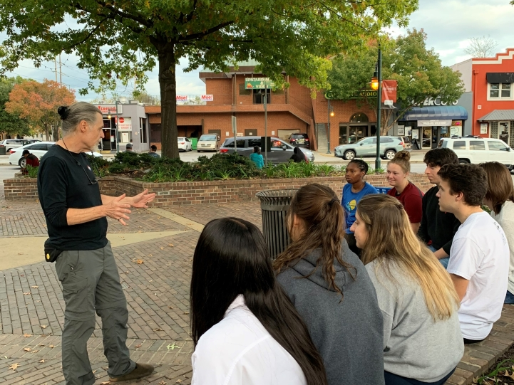 COLA 298 students in Five Points during a 'history lesson' from Don, a long-time business owner in the area